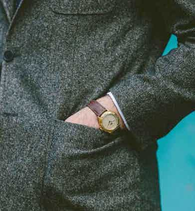 """""""This watch doesn't actually work,"""" James laughs when he examines it. """"I saw it in a vintage market in Camden and loved the rose gold and brown leather strap. I've always been more into a leather strap than a metal bracelet."""""""