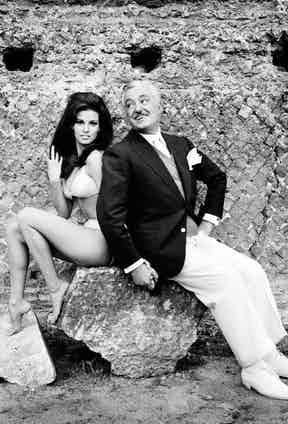 Italian actor Vittorio De Sica holding the hand of American actress Raquel Welch, in the film 'The Biggest Bundle of Them All', 1968.
