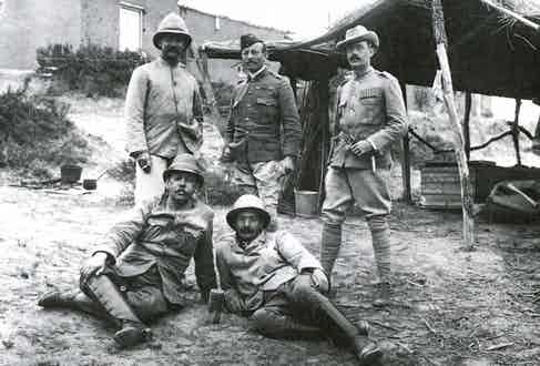 Boer War newspaper correspondents together with soldiers wearing early safari-style jackets and Khaki Drill uniforms, respectively, circa 1900.