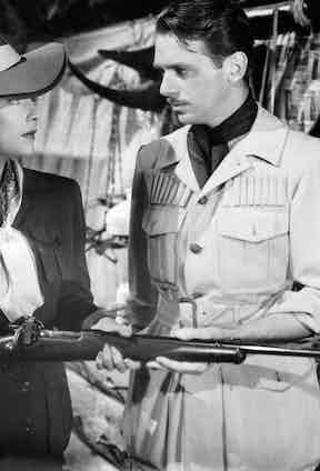 Madeleine Carroll and Douglas Fairbanks with their own take on safari chic in Safari, 1940.