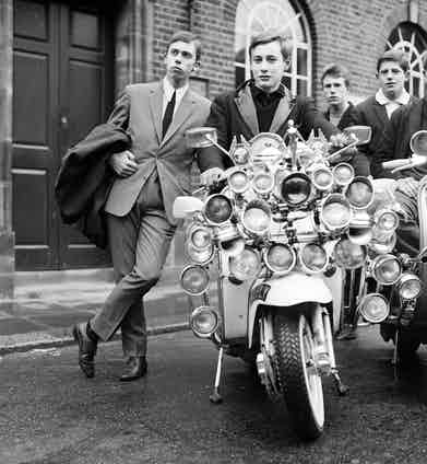 Mods and their elaborate scooters in Peckham, London, 1964. Photo by © Daily Mirror/Mirrorpix/Corbis.