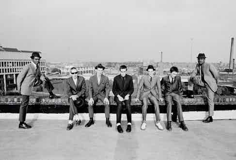 English ska revival band The Specials photographed on the roof of the Coventry Odeon during the shoot for their first LP, 1979. Left to right: Lynval Golding, Jerry Dammers, Roddy Radiation, Terry Hall, Horace Panter, John Bradbury and Neville Staple. Photo by Chalkie Davies/Getty Images.