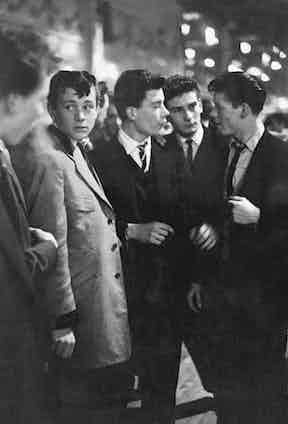 A group of teddy boys enjoy an evening out at the Mecca Dance Hall in Tottenham, London, 1954. Photo by Picture Post /Hulton Archive/Getty Images.