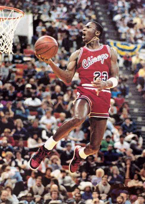 Michael Jordan competing in the NBA Slam Dunk Competition, 1985.