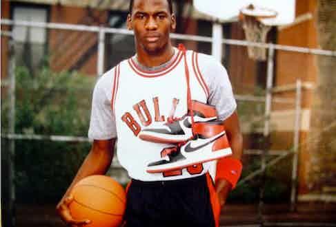 Michael Jordan holding Air Jordan 1 trainers for his Nike campaign, 1985.