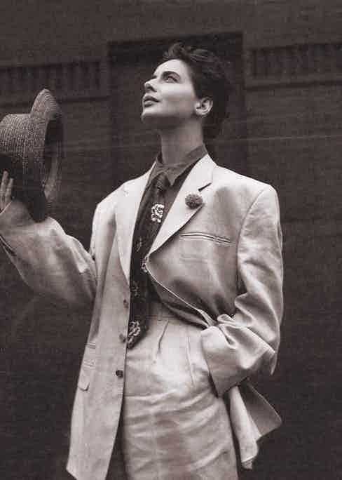 Rossellini poses in an androgynous trouser suit and her signature short hair style, circa 1990.