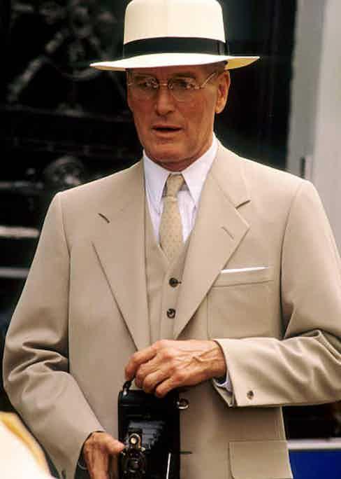 Paul Newman wears a Panama hat with an ecru suit in Mr & Mrs Bridge, 1990.