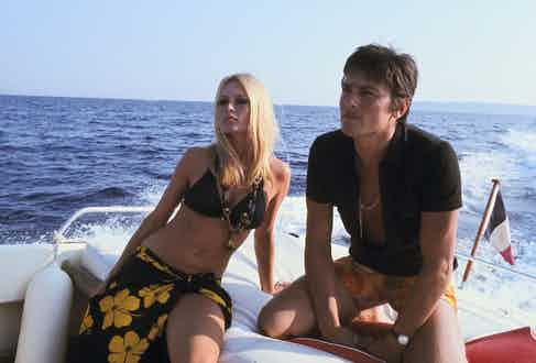 Brigitte Bardot and Alain Delon cruise around St. Tropez aboard a speedboat in 1968.