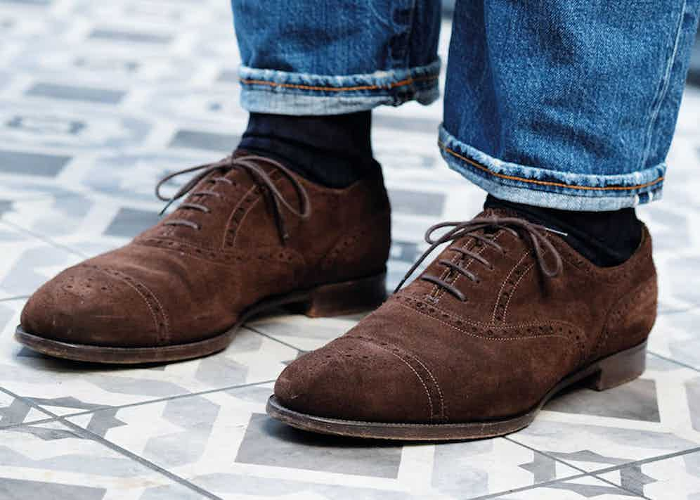"""""""Edward Green is by far my favourite shoemaker. I find Italian and French shoes too long,"""" Alessandro tells me. He wears a bespoke model that's crafted on Edward Green's 202 last and that pops with his heavily distressed five-year-old Fortela jeans."""