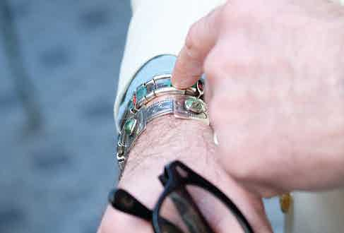 Approaching a century old, both of Alessandro's bracelets are of Navajo heritage. The one he is pointing at was a gift on his 40th birthday, and the other is from Santa Fe, made from a 1920s silver dollar coin.