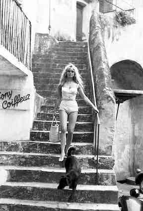 Bardot wonders the streets of Saint-Tropez barefoot, c. 1962.