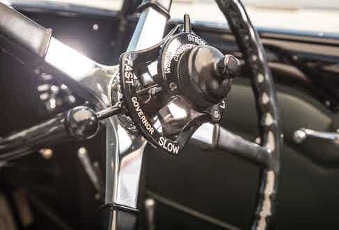 The large, four spoke steering wheel dominates much of the interior.