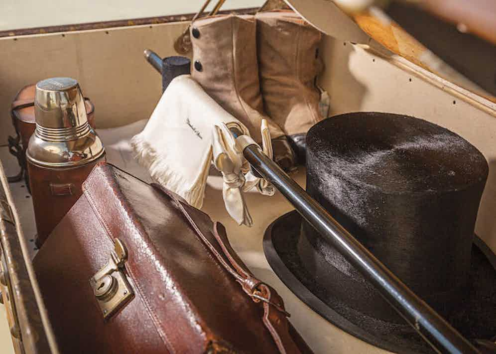 A Louis Vuitton motoring trunk complete with top hat, white bow-tie, cuff and collar boxes, a scarf from Turnbull & Asser, and dancing and tap shoes.
