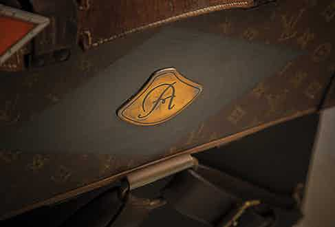 The Louis Vuitton motoring trunk replete with monogram.