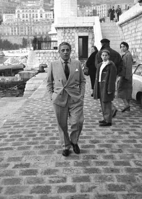 Greek billionaire shipowner Aristotle Onassis strolls along Montecarlo's port, 1961. Photo by Carlo Bavagnoli/Mondadori Portfolio via Getty Images.