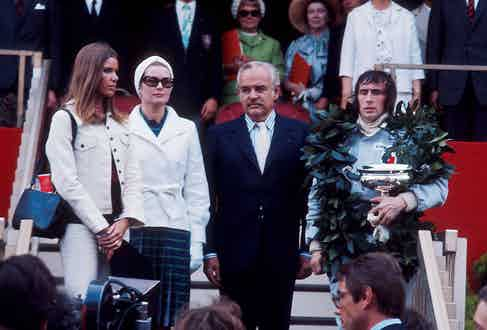 Jackie Stewart stands alongside Prince Rainier, Princess Grace and his wife Helen Stewart after winning the 1973 Monaco Grand Prix. Photo by LAT Photographic/REX/Shutterstock.