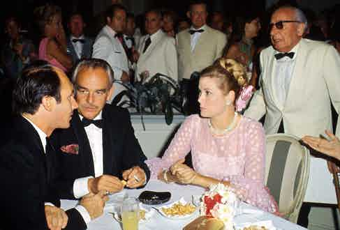 Karim Aga Khan converses with Prince Rainier III and Princess Grace of Monaco at the Mycca Gala, 1970. Photo by RDA/Getty Images.