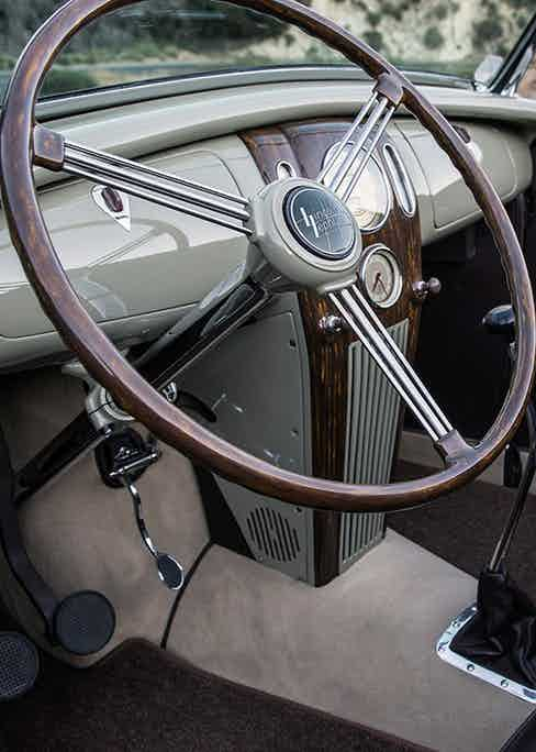"""For the 1936 Ford Roadster """"Long Beach Legend"""", a '37 Zephyr dash was sourced and fitted, along with original unrestored Stewart Warner gauges, Zephyr wheel covers and steering wheel."""