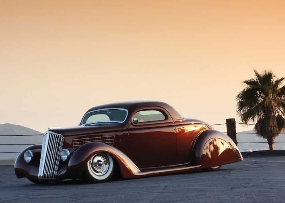 """The 1935 Ford Coupe """"Ruby Deluxe"""" features hand-made rear fenders and skirts, bonnet and dashboard and was awarded the 2011 Good Guys """"Kustom of the Year"""" award."""