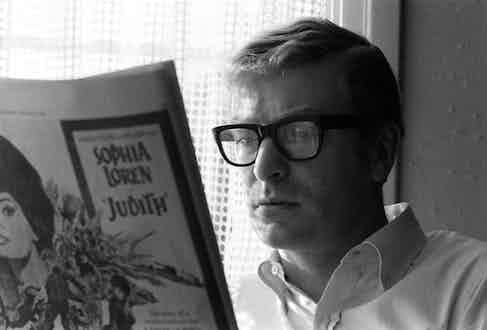 Reading a newspaper in Los Angeles in 1966. Notice the perfect collar roll of his button-down shirt. Photo By Bill Ray/The LIFE Premium Collection/Getty Images