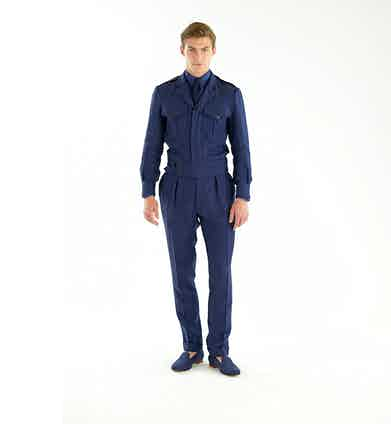 Ralph Lauren Purple Label: Part mechanic, part aviator, this ensemble appears as though it's a one piece, although it's actually made up of a belted linen herringbone sport coat and matching trouser combination.