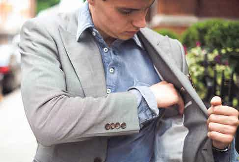 Dark blue long sleeve acid washed pique polo shirt, Naked Clothing; grey suit, Chester Barrie; watch, Rolex property of The Rake.