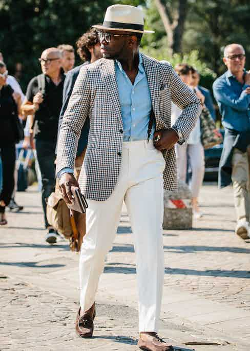 Clip-on braces are utilised subtly here under the check sport coat. The rakish addition of the Panama hat and Belgian loafers are well executed, too.
