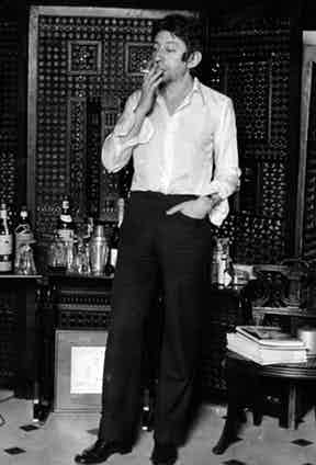 This look epitomises his nonchalant attitude with undone cuffs and cigarette in hand, circa 1967.