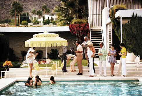 Guests by the pool at Nelda Linsk's desert house in Palm Springs, January 1970. The house was designed by Richard Neutra for Edgar J. Kaufmann. Photo by Slim Aarons/Hulton Archive/Getty Images.