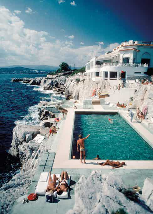 Guests around the swimming pool at the Hotel du Cap Eden-Roc, Antibes, France, August 1969. Photo by Slim Aarons/Hulton Archive/Getty Images.