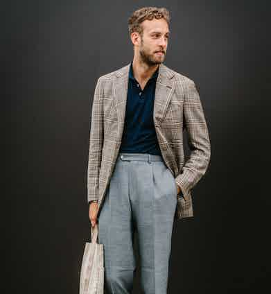 Andreas Weinas showcasing how to effectively wear a polo shirt with tailoring.