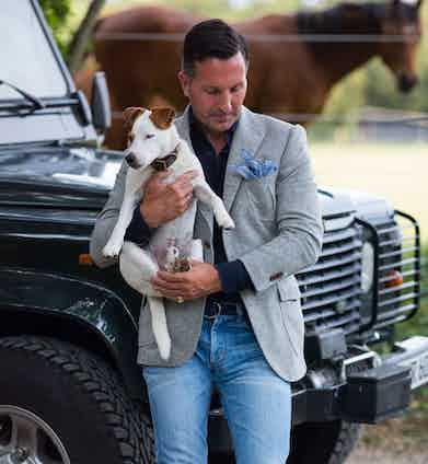 Alexander Kraft, with his dog Bertie, wears bespoke Cifonelli.