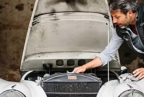 Francois Pourcher tends to his Jaguar XK-120.