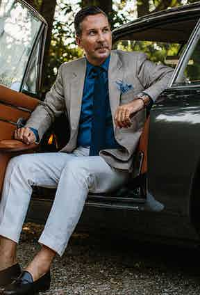 Alexander Kraft wearing Huntsman's brown and white check linen blazer and a pair of Carmina tassel loafers.