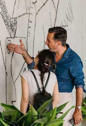 Alexander Kraft and Le Nouvel Observateur's Virginie Grolleau inspect a Picasso fresco.