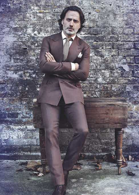 The Rake issue 45 cover star Andrew Lincoln wearing a brown silk double-breasted suit, cream silk dress shirt, and brown knitted silk tie by Ralph Lauren Purple Label, and a grey silk pocket square by Budd Shirtmakers.