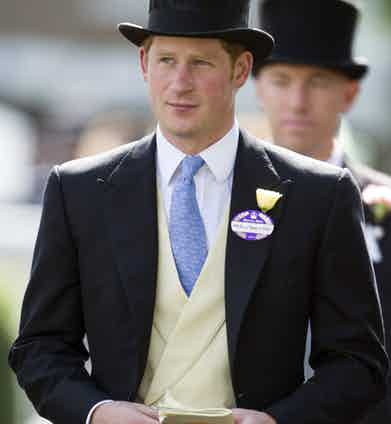 Prince Harry wearing a buff coloured double-breasted waistcoat underneath his perfectly fitting morning coat at Ascot in 2014. He boldly chose to forgo the pocket square, which gives his top half a clean, minimal appeal.