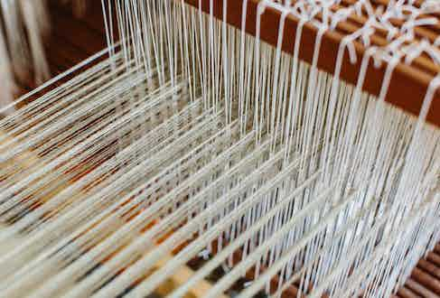 Linen being delicately woven.