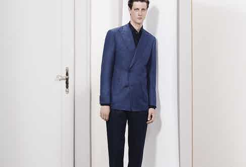 Corneliani: Tonal simplicity, featuring an unstructured double-breasted jacket over a navy shirt and trousers.