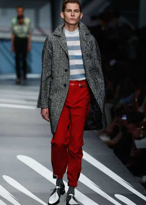 Prada: Prada referenced Paul Weller in his Style Council years with this summer tweed overcoat. The bold red, pegged trousers are another example of the wide, tapered style.