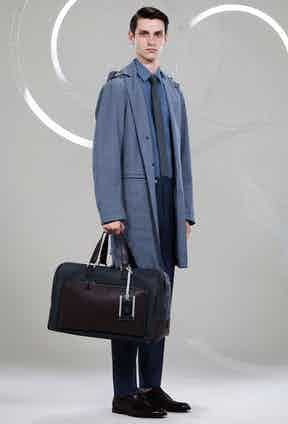 Canali: A strong, tonal look from Canali, making use of their new Impeccabile 2.0 fabric in the hooded mackintosh jacket. An ultra-fine wool, its fibres have been twisted twice as many times as traditional threads, for ultimate crease-resistance.