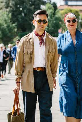 The safari jacket's rise continues. Worn here with a seersucker shirt, tailored denim trousers and, once again, a neckerchief.
