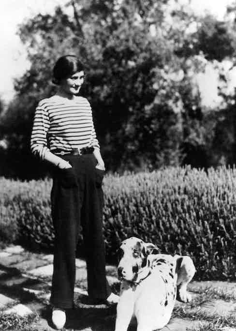 Coco Chanel at her home, Villa La Pausa in Roquebrune, in the French Riviera with her dog, Gigot, circa 1930.