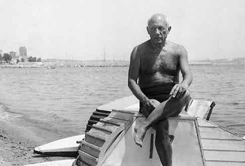 Pablo Picasso relaxes on holiday, circa 1950.