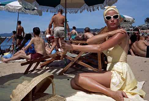 Grace Kelly sunbathing in Nice during filming of To Catch a Thief, 1955.