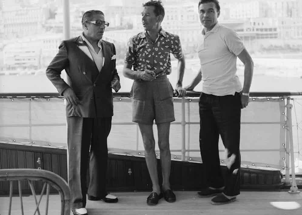 On board Aristotle Onassis' yacht 'Christina' with Porfirio Rubirosa in Monte Carlo, 1958. Photo by Slim Aarons/HultonArchive/Getty Images.