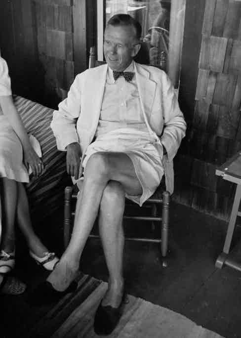 General George C. Marshall wearing Bermuda shorts, a linen sports coat, bow tie and no socks on the porch of his summer cottage at Fire Island, New York, 1939.
