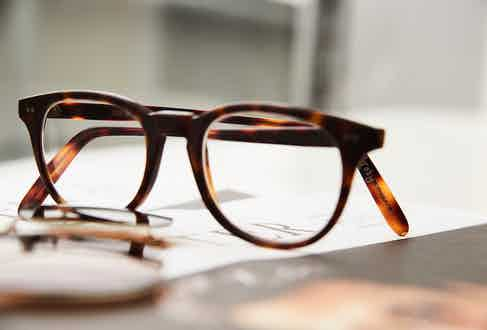 These gorgeous Cutler and Gross matte tortoiseshell bespoke frames with his name engraved in the inside of the right arm clearly gets some wear, as his surname has become somewhat faded over the years. They are matched with an Oliver Peoples x Kitsuné detachable clip-on polarised lens.
