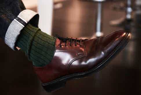 Traditional and yet modern too, these English-made Edward Green shoes made from cordovan leather have worn beautifully and are matched with thick Corgi cotton socks and turn-up jeans from RRL.