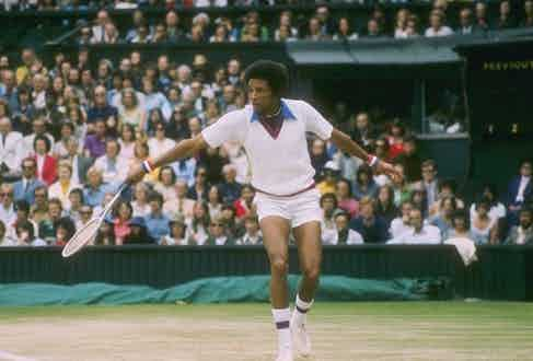 Arthur Ashe's pointed blue collar, thick coloured stripes and chunky wristbands wouldn't comply with Wimbledon's regulations today.